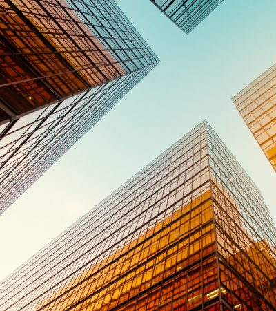 office buildings and blue sky in business district -